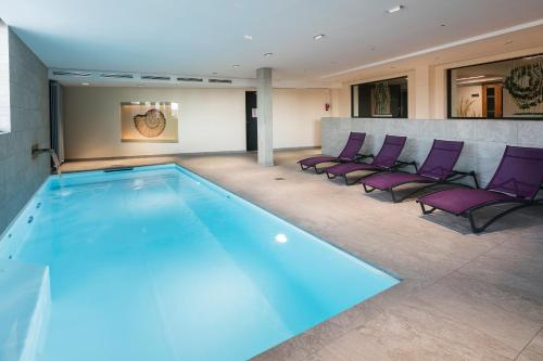 The swimming pool at or near Best Western Hotel & SPA Le Schoenenbourg