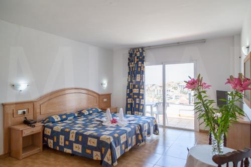 Cama o camas de una habitación en Hotel Casa del Sol