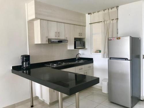 Una cocina o zona de cocina en Cantabria House Suites