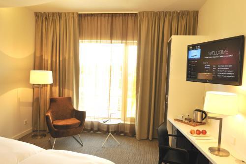 Een TV en/of entertainmentcenter bij Hotel Udens Duyn