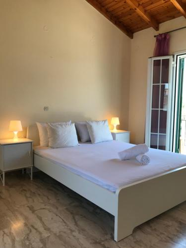 A bed or beds in a room at Wooden Ceiling apartment close to city center