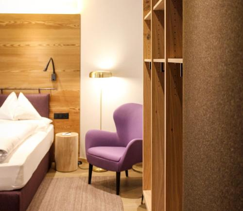 A bed or beds in a room at Chalet Silvretta Hotel & Spa