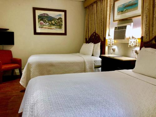 A bed or beds in a room at Canario Boutique Hotel