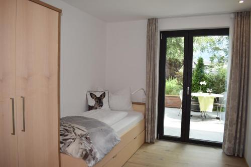Ein Bett oder Betten in einem Zimmer der Unterkunft Residence Ladurn