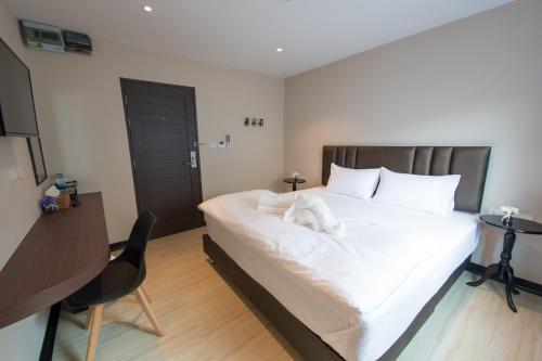 Cama o camas de una habitación en Let's Zzz Bangkok
