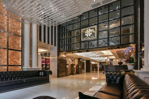 The lobby or reception area at Harmonious Hotel