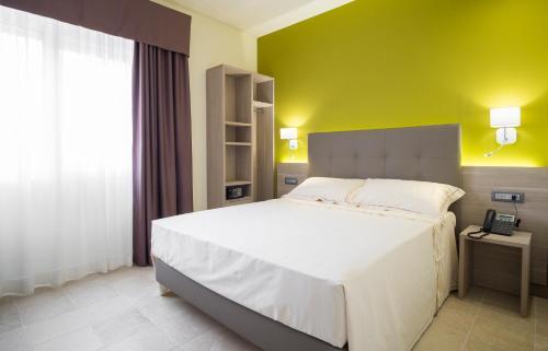 Letto o letti in una camera di Netum Hotel