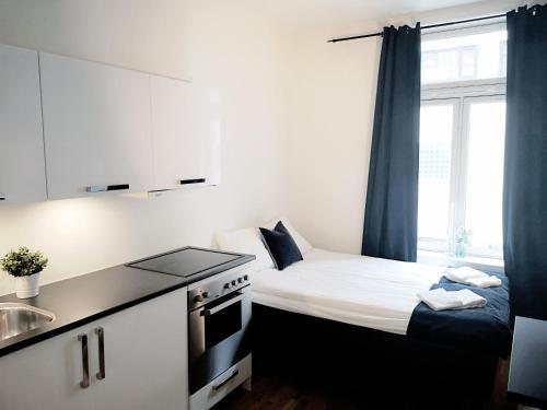 Un ou plusieurs lits dans un hébergement de l'établissement Forenom Serviced Apartments Oslo Royal Park