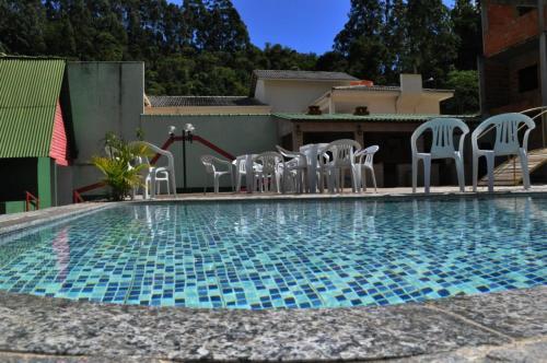 The swimming pool at or near Pousada Chale Pico da Bandeira