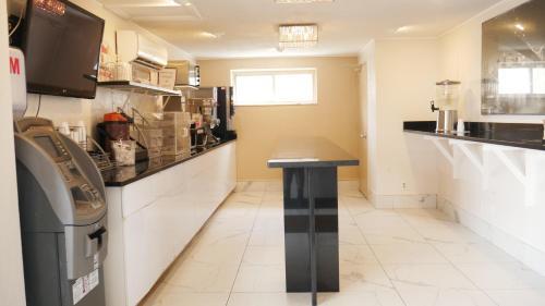 A kitchen or kitchenette at Super 8 by Wyndham North Bergen NJ/NYC Area