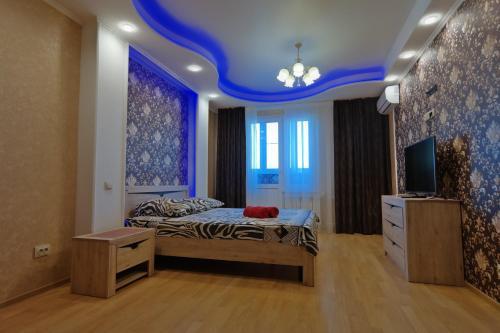 Кровать или кровати в номере Апартаменты Бизнес класса Вега