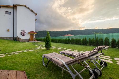 A garden outside Villa ADELHEIDE - Spa, Jacuzzi, BBQ