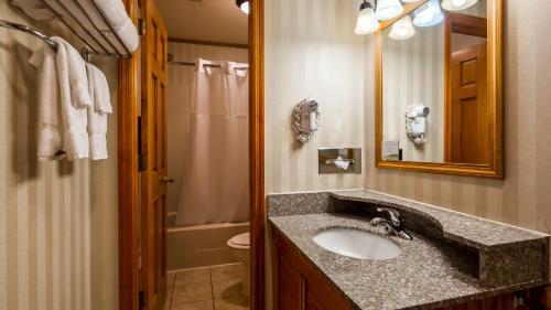 A bathroom at Best Western Adirondack Inn