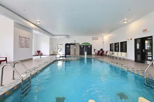 The swimming pool at or near Super 8 by Wyndham Quebec City