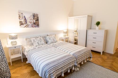 Łóżko lub łóżka w pokoju w obiekcie Trip Apartments