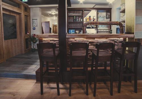 Ein Restaurant oder anderes Speiselokal in der Unterkunft Brauereigasthof Marktmühle