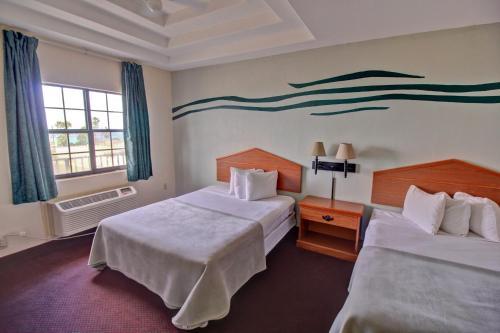 The Inn at South Padreにあるベッド