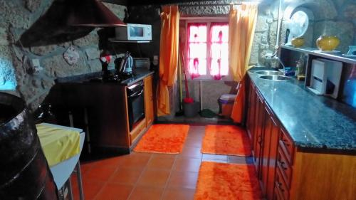 A kitchen or kitchenette at Casa leão