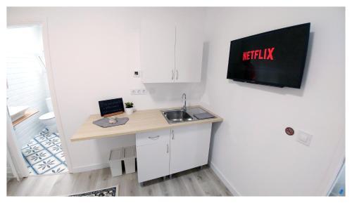 Телевизор и/или развлекательный центр в Casa Lagunera