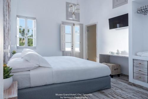 Un ou plusieurs lits dans un hébergement de l'établissement Museo Grand Hotel
