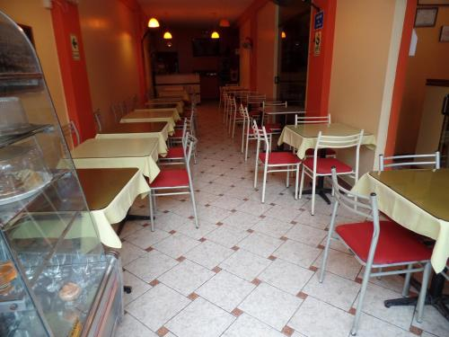 Restaurant ou autre lieu de restauration dans l'établissement Hostal Amigos