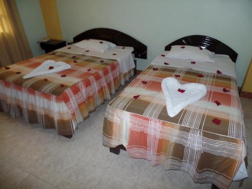 Un ou plusieurs lits dans un hébergement de l'établissement Hostal Amigos