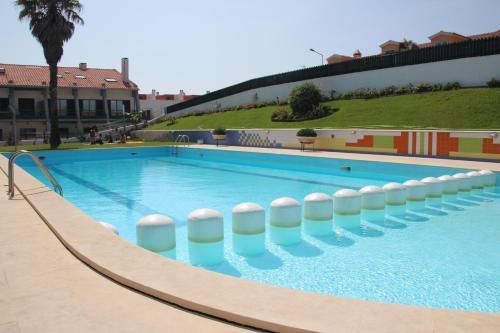 The swimming pool at or near casa de pedra branca