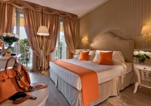 Кровать или кровати в номере Grand Hotel Imperiale
