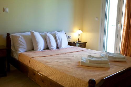 Ένα ή περισσότερα κρεβάτια σε δωμάτιο στο Ευαγγελία