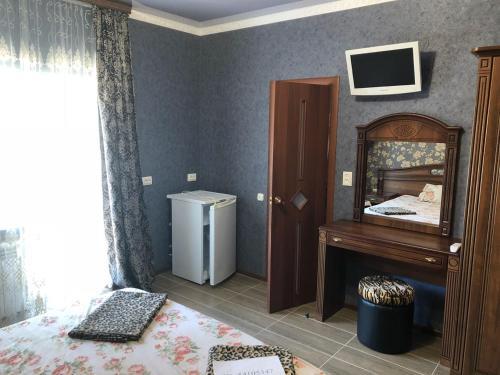 Телевизор и/или развлекательный центр в Гостевой дом Афина