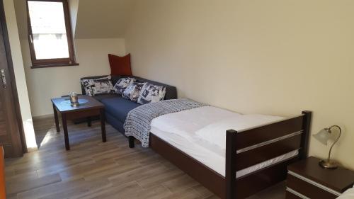 Łóżko lub łóżka w pokoju w obiekcie Sarna Karkonosze