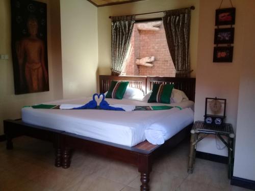 Ein Bett oder Betten in einem Zimmer der Unterkunft Baan Ton Rak Boutique Resort