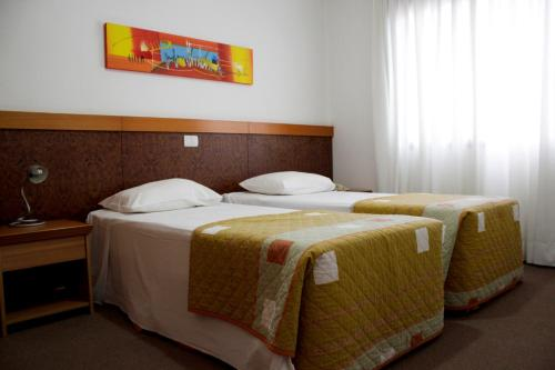 A bed or beds in a room at Apto no Union Residence
