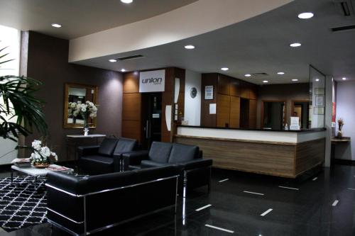 The lobby or reception area at Apto no Union Residence