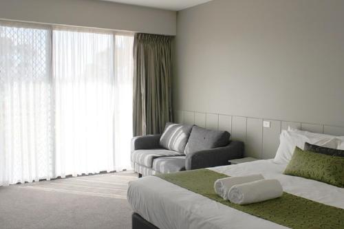 A bed or beds in a room at Club Mulwala Resort