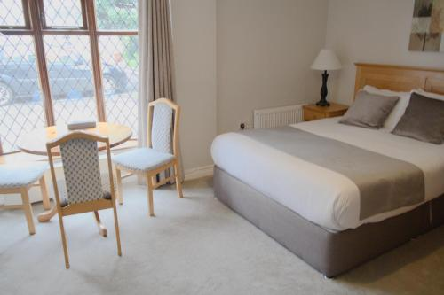 A bed or beds in a room at Latchfords Townhouse