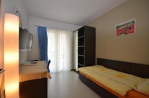 Ein Bett oder Betten in einem Zimmer der Unterkunft Albergo Elvezia
