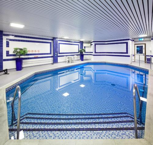 The swimming pool at or near Mercure Swansea Hotel