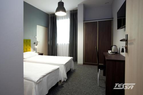 Łóżko lub łóżka w pokoju w obiekcie Pokoje Gościnne Tessa