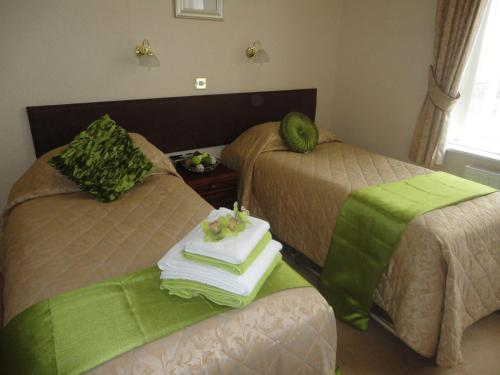 A bed or beds in a room at Bourne Hall Country Hotel