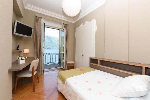 Ein Bett oder Betten in einem Zimmer der Unterkunft Hotel Walter Au Lac