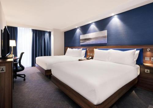 A bed or beds in a room at Hampton by Hilton Dundee
