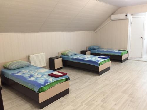 Кровать или кровати в номере Гостевой дом Чемодан