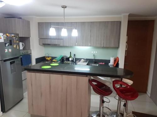 Una cocina o zona de cocina en Condominio Atracción