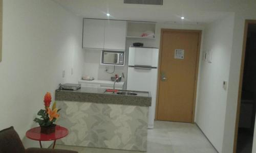 A kitchen or kitchenette at Flat Edifico Paiva Homestay Apt 405