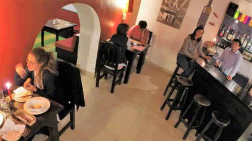 A restaurant or other place to eat at Hostal L'Auberge Inn