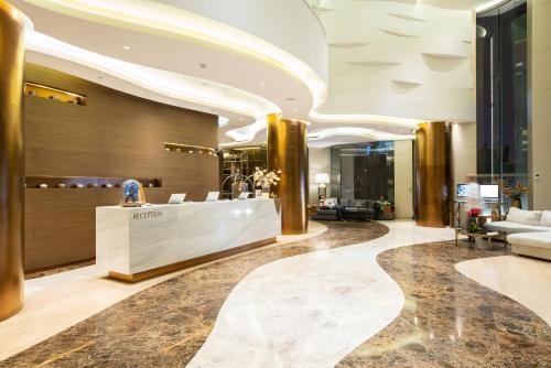 The lobby or reception area at Ashley Wahid Hasyim Jakarta