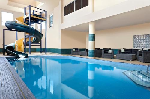 The swimming pool at or near Four Points by Sheraton Calgary West