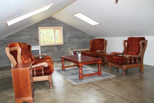 A seating area at Lækjarhus Farm Holidays
