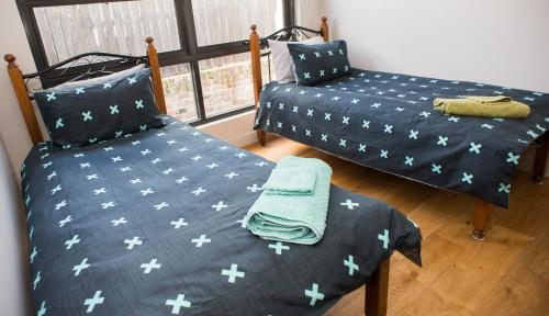 A bed or beds in a room at Jamila